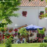 Foto Casa decorada con geranios en Guadalix 1